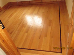 Hardwood flooring with inlay installed by Woods Carpentry in Leitrim